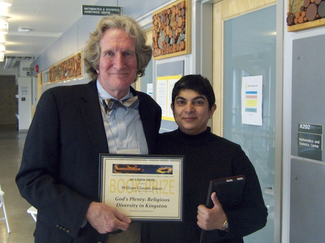 Dr. James accepting his award from current CSSR President, Dr. Ruby Ramji, at Congress in Victoria, B.C., on June 1, 2013